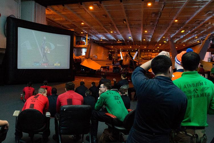 For years, Sailors and Marines such as those pictured here in 2016 watching Super Bowl 50 aboard the USS John C. Stennis (CVN 74) have received three AFN TV services while afloat.  Starting Jan. 30th, they'll start receiving AFN|sports2, giving them four AFN TV services. (U.S. Navy photo by Mass Communication Specialist Seaman Tomas Compian /Released)