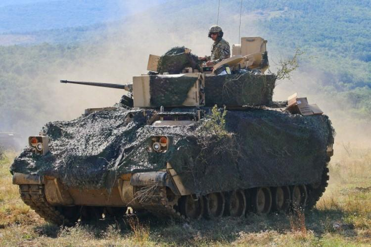 A crew from the 1st Armored Brigade Combat Team maneuvers its M2A3 Bradley Fighting Vehicle during an exercise at Novo Selo Training Area, Bulgaria, in August 2018. The Army has canceled its competition to replace the Bradley after receiving only one qualifying bid. (JAMAR MARCEL PUGH/U.S. ARMY)