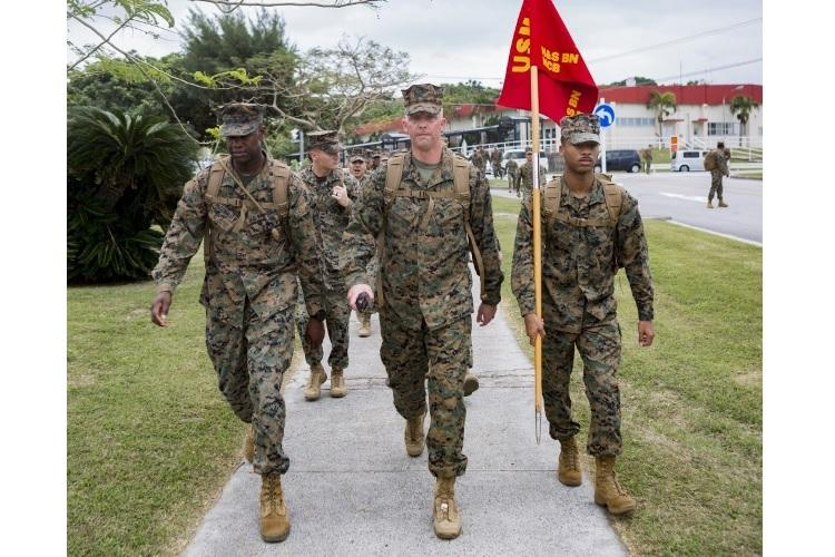 U.S. Marines and sailors assigned to Headquarters and Support Battalion, Marine Corps Installations Pacific, participate in a hike in honor of Martin Luther King Jr. around Camp Foster, Okinawa, Japan on Jan. 16, 2019. The purpose of the hike was to commemorate Dr. King's life and his struggle to combat racial inequality through nonviolent resistance and civil disobedience. (U.S. Marine Corps photo by Cpl. Christopher A. Madero)