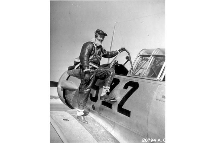 Gen. Benjamin O. Davis Jr., poses for a photo next to his plane during World War II as a colonel commanding the Tuskegee Airmen. (Photos courtesy of Wikimedia Commons)