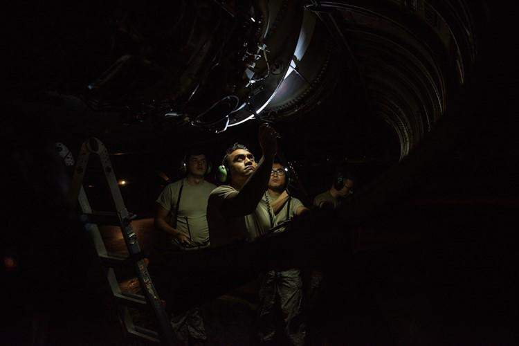 Airmen assigned to the 69th Aircraft Maintenance Squadron inspect a B-52H Stratofortress engine before a flight at Andersen Air Force Base, Guam, Feb. 3, 2020. Strategic bomber missions enhance the readiness and training necessary to respond to any potential crisis or challenge across the globe. (U.S. Air Force photo by Airman 1st Class Michael S. Murphy)