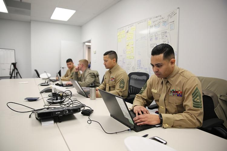 MARINE CORPS BASE QUANTICO, Virginia - Marines with Marine Corps Recruiting Command G3 Team develop user stories for the Marine Corps Recruiting Information Support System II Feb. 8, in Stafford, Virginia. Marine Corps Systems Command has partnered with Marine Corps Recruiting Command to develop MCRISS II with the goal of making the job of recruiters a little easier. (Photo by Joseph Neigh)