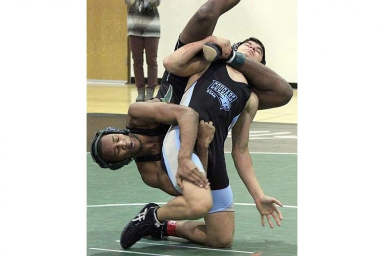 Osan's Marcus Inthavixay lifts Daegu's Gavin Jackson in the 158-pound bout during a DODEA-Korea wrestling quad meet at Camp Walke rin January. Inthavixay won a 12-9 decision and has gone unbeaten against Jackson this season. (MARY SARANTAKES/SPECIAL TO STRIPES)