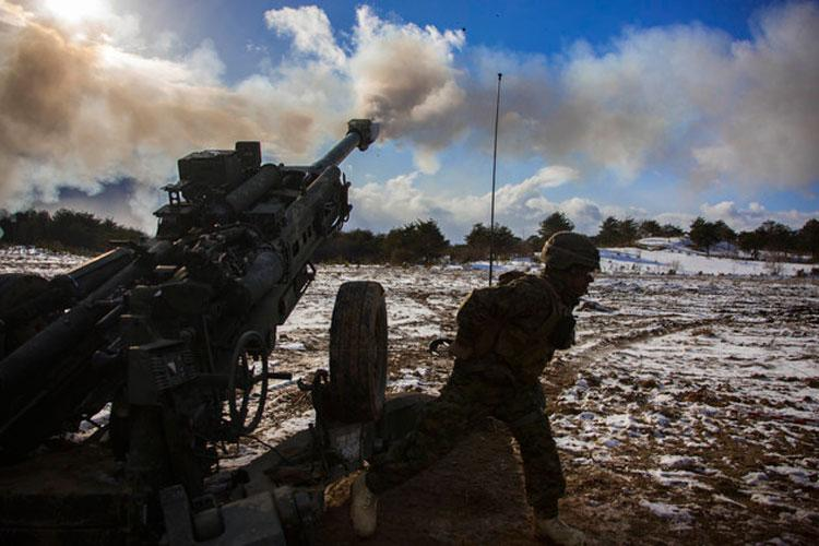 U.S. Marine Corps Lance Cpl. Johnathan Delgado, a field artillery Marine with 3rd Battalion, 12th Marine Regiment, 3rd Marine Division, fires a M777 Howitzer in the Ojojihara Maneuver Area, Miyagi Prefecture, Japan, Feb. 10, 2019. (U.S. Marine Corps photo by Lance Cpl. Christian Ayers)