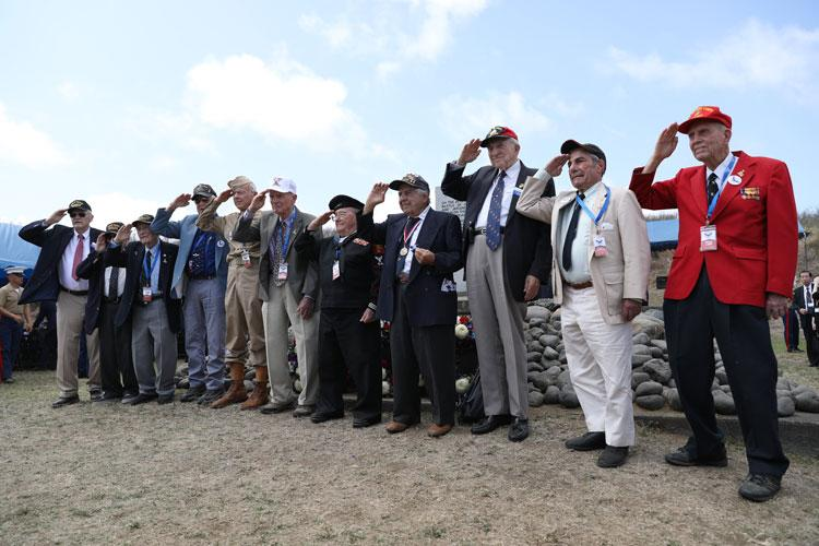 U.S. Marine Corps, Army and Navy World War II veterans render honors during the 74th Annual Reunion of Honor ceremony March 23, 2019 at Iwo To, Japan. Dozens of WWII veterans and veterans of the Battle of Iwo Jima took part in the ceremony. The Reunion of Honor ceremony is held annually to commemorate the heroism and sacrifices made by service members during the Battle of Iwo Jima in World War II. (U.S. Marine Corps photo by Sgt. Tiffany Edwards)