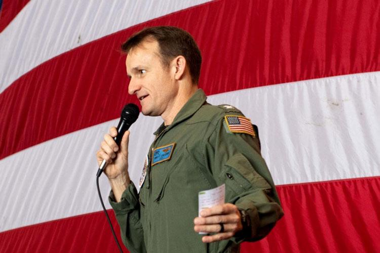 Capt. Brett Crozier, then-commanding officer of the aircraft carrier USS Theodore Roosevelt addresses the crew during an all-hands call in the ship's hangar bay March 3, 2020. Crozier was relieved of command after his letter that warned sailors could die from the coronavirus outbreak aboard the carrier was leaked to the media. (KAYLIANNA GENIER/U.S. NAVY)