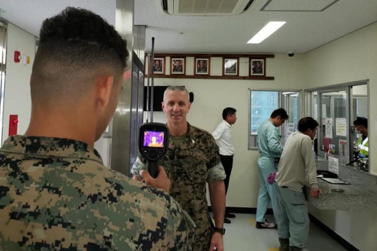 Col. Vincent Ciuccoli, commander of Headquarters and Support Battalion at Camp Smedley D. Butler, is screened for coronavirus symptoms at Camp Schwab, Okinawa, March 30, 2020. (U.S. MARINE CORPS)