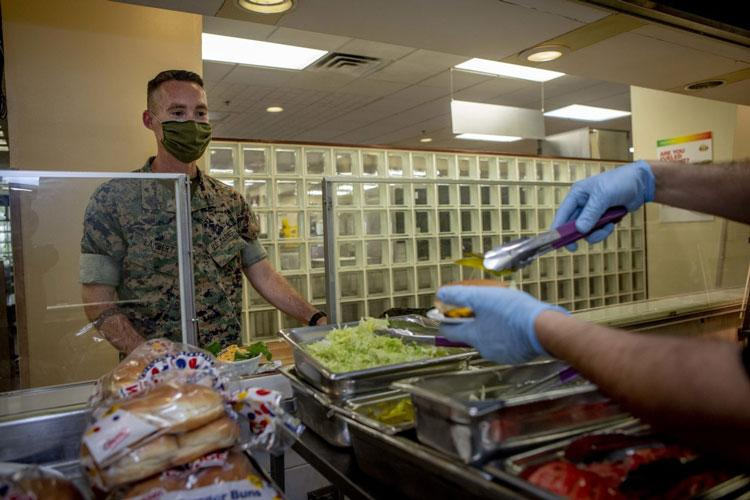 Mess hall patrons test a new menu item, May 13, 2020 at Marine Corps Air Station Futenma, Okinawa, Japan. In an effort to be more inclusive of Marines with different lifestyles, MCAS Futenma's mess hall was the first military dining facility on Okinawa to introduce a plant-based burger to it's menu. (U.S. Marine Corps photo by Cpl. Christopher A. Madero)
