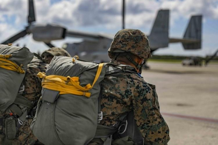 U.S. Marine Corps air delivery specialists prepare to board an MV-22 Osprey for an air delivery exercise June 6, 2019 on Marine Corps Air Station Futenma, Okinawa, Japan. (U.S. Marine Corps photo by Lance Cpl. Mark Fike)
