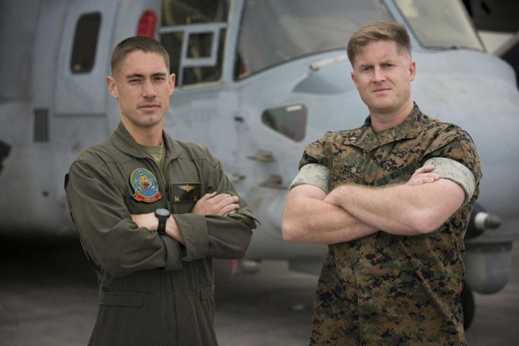 Cpl. Kyle Daly, left,  stands with 1st. Lt. Sam LaPorte from his unit, Marine Medium Tiltrotor Squadron 262, 1st Marine Aircraft Wing. In April, the unit participated in a running challenge in which Daly logged over 200 miles. Daly, a southern California native, is a crew chief for VMM-262. (U.S. Marine Corps photo by Lance Cpl. Ryan Persinger)