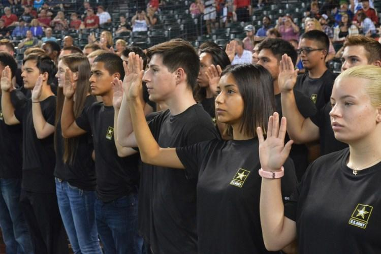 As part of a mass enlistment ceremony, Army recruits from the Phoenix Recruiting Battalion recite the oath of enlistment, Aug. 26, 2018, Chase Field, Phoenix. The Army came up short in 2018 of meeting its recruiting goal of enlisting 76,500 soldiers. By the end of this fiscal year on Sept. 30, the Army's goal is to add 68,000 new active-duty recruits. (MIKE SCHECK/U.S. ARMY PHOTO)