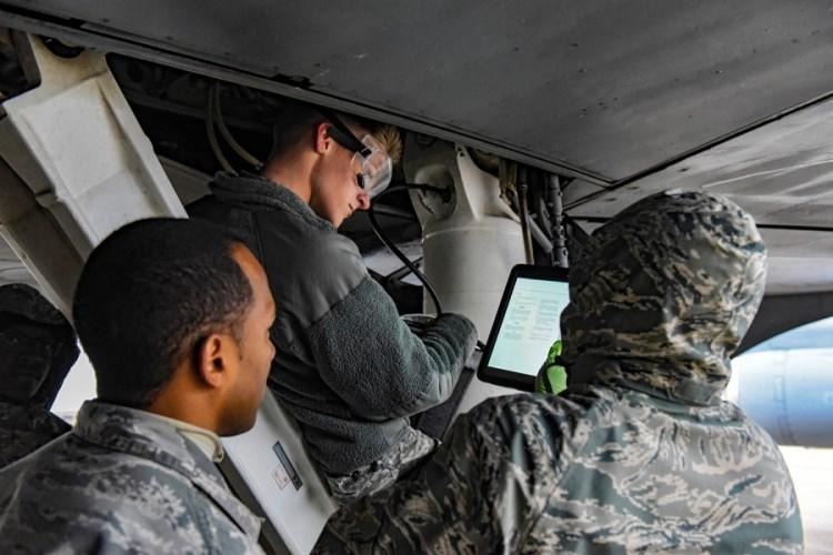 Air Force instructor Tech. Sgt. Brandon Garcia, left, watches airmen Jacob Blann, center, and Michael Aytiah as they learn to service a KC-135 Stratolifter at Sheppard Air Force Base, Texas, Dec. 13, 2018. (PEDRO TENORIO/U.S. AIR FORCE)