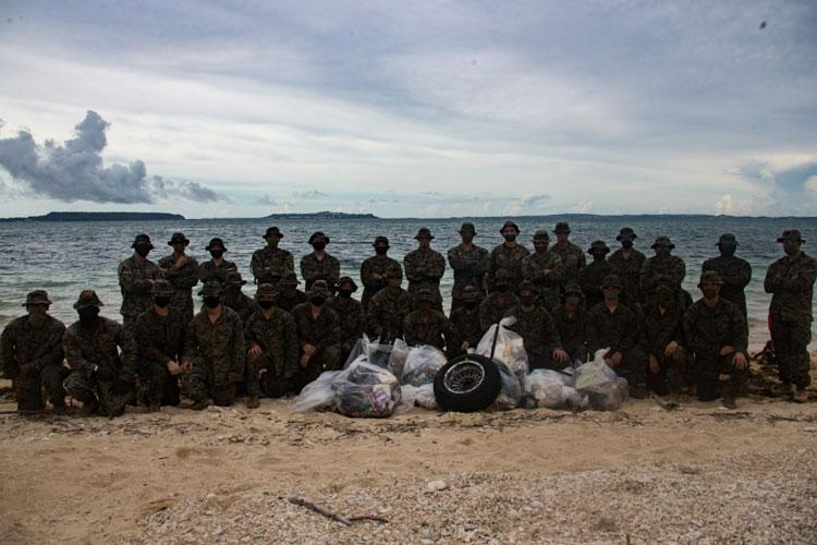 Marines with Combined Anti-Armor Team 1 (CAAT), Battalion Landing Team, 2nd Battalion, 4th Marines, 31st Marine Expeditionary Unit (MEU), pose for a group photo following a beach cleanup at Kin Blue, Okinawa, Japan, July 25, 2020. (U.S. Marine Corps photo by Lance Cpl. Kolby Leger)