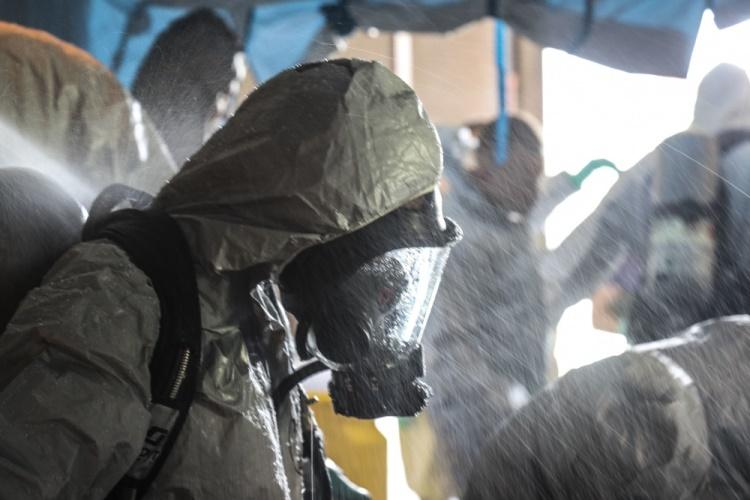 U.S. Marine Corps Lance Cpl. Kimberly Ortiz Marrero, a native of Lancaster, N.Y. and the hazardous material and safety representative for 3rd Transportation Support Battalion, stands while being decontaminated during the Hazardous Waste Operations and Emergency Response course at Camp Foster, Okinawa, Japan, Sept. 19, 2019. (U.S. Marine Corps photo by Lance Cpl. Ryan H. Pulliam)