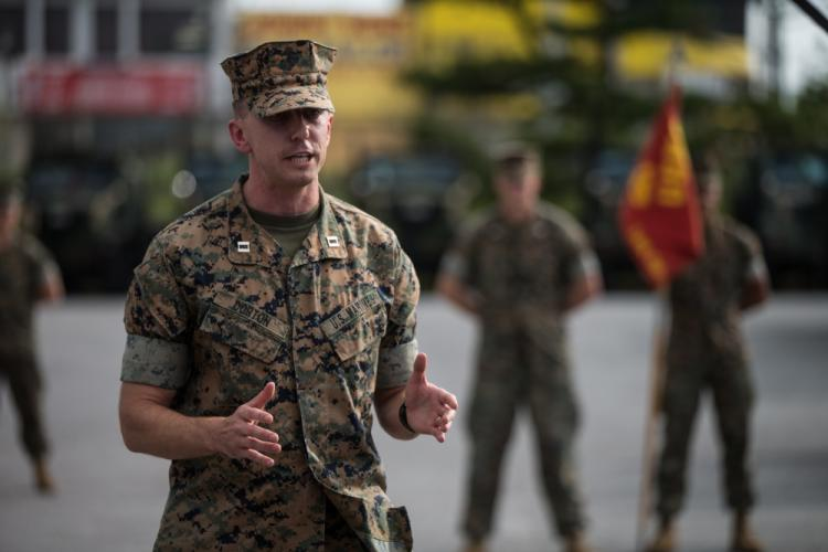 U.S. Marine Corps Capt. Matthew Dorton, the oncoming company commander for Truck Company, Headquarters Battalion, 3rd Marine Division, gives remarks during a change of command ceremony on Camp Hansen, Okinawa, Japan, Oct. 25, 2019. During the ceremony, the transfer of the company colors, symbolizing the transfer of responsibility and authority of Truck Company, was performed by the outgoing and incoming commanders.