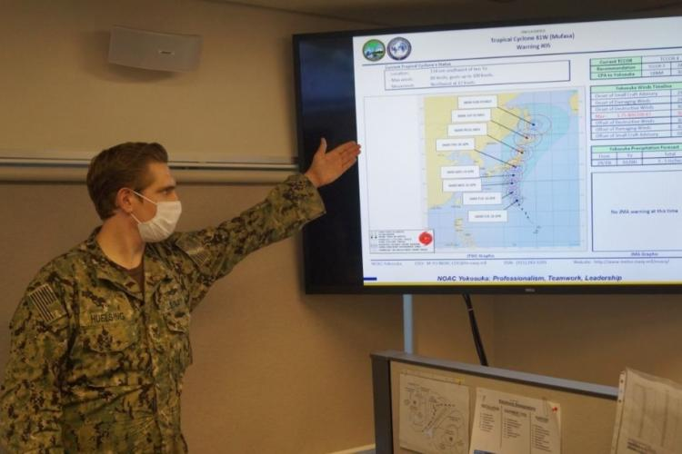 AG1 Huelsing from the Naval Oceanography Anti-Submarine Warfare Center (NOAC) in Yokosuka, Japan, briefs the Tropical Cyclone Condition of Readiness (TCCOR) winds timeline for Commander Fleet Activities Yokosuka (CFAY) as part of the annual Typhoon Ready Reliant Gale (TRRG) exercise on Apr. 26, 2020.