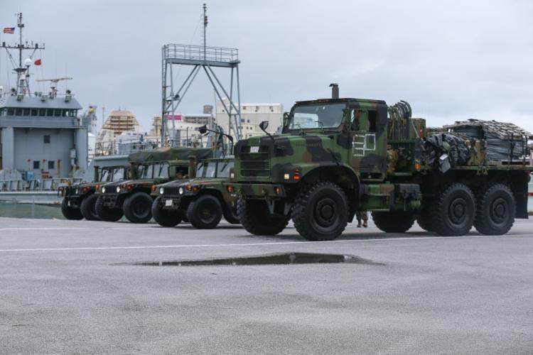 U.S. Marines with Combat Logistics Regiment 3, 3rd Marine Logistics Group offload tactical vehicles on Naha Military Port, Okinawa, Japan, June 25, 2020. Marines with CLR-3 participate in a command post exercise that enhances the Marines' ship-to-shore movement capabilities. (U.S. Marine Corps photo by Cpl. Ryan Harvey)