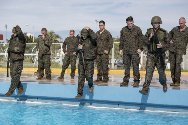U.S. Marines with Marine Corps Installations Pacific, complete their swim qualification at the Foster Aquatic Center on Camp Foster, Okinawa, Japan, Nov. 20, 2020. All Marines are required to complete the Water Survival Basic swim qualification every two years and have a follow-on opportunity to attempt the advanced Water Survival Intermediate course. (U.S. Marine Corps photo by Lance Cpl. Zachary Larsen)