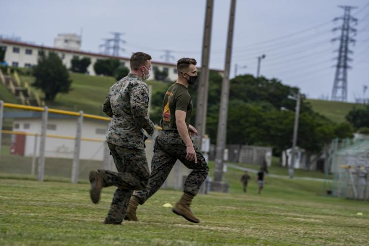 U.S. Marine Corps Jordan M. Knupp, the battalion training noncommissioned officer in charge with Headquarters and Support Battalion, instructs a Marine through the combat fitness test on Camp Foster, Okinawa, Japan, Nov. 25, 2020. The CFT is an annual requirement and is designed to assess a Marine's physical capacity in a broad spectrum of combat related tasks. (U.S. Marine Corps photo by Cpl. Brennan J. Beauton)