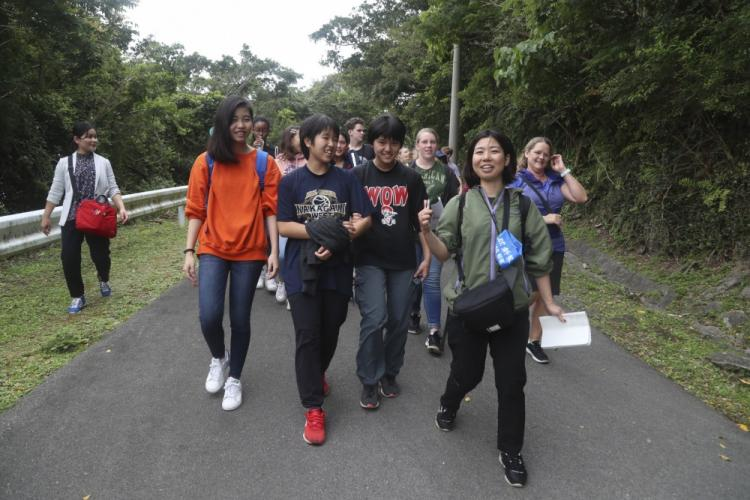 Students from Camp Lester Middle School and Chatan Junior High School students walk together during a culture exchange at Chatan Castle on Camp Smedley D. Butler, Okinawa, Japan, March 21, 2019. The exchange was held to promote a better relationship with the local community. (U.S. Marine Corps photo by Lance Cpl. Savannah Mesimer)