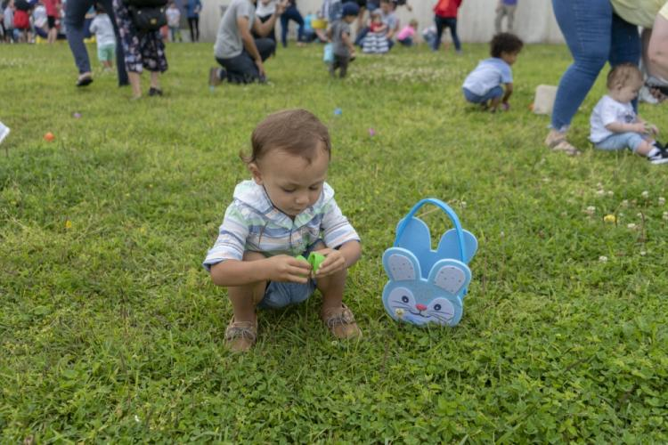 Children gather eggs filled with candy during the 2019 Camp Courtney Easter Egg Hunt April 20, 2019. Members of the U.S. and local communities participated in the Easter egg hunt. (U.S. Marine Corps photo by Pfc. Karis Mattingly)