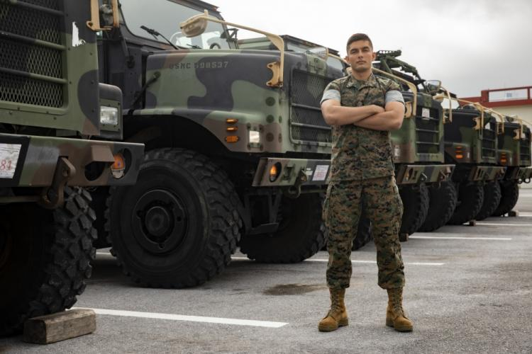 U.S. Marine Corps Cpl. Chad R. Cruz stands in front of an MTVR 7-ton truck at Camp Kinser, Okinawa, Japan on April 23, 2019. Cruz was awarded the Motor Transportation Operator of the Year award for his hard work and enthusiasm as a motor transportation operator. Cruz, a native of Ewa Beach, Hawaii, is with Headquarters and Service Company, 3rd Supply Battalion, Combat Logistics Regiment 35, 3rd Marine Logistics Group. (U.S. Marine Corps photo by Lance Cpl. Armando Elizalde)