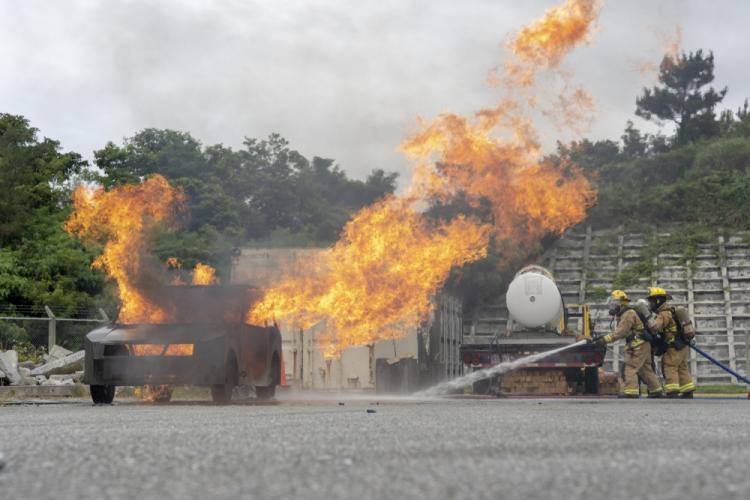 Marine Corps Installations Pacific Fire and Emergency Services extinguish a simulated vehicle fire May, 29, 2019 at Camp Hansen, Okinawa, Japan. MCIPAC Fire and Emergency Services trained alongside Kadena Fire Department Rescue Technicians and Navy Corpsman from the U.S. Naval Hospital Okinawa to engage scenarios of possible terrorism and, or, structural collapse due to the environmental elements presented on Okinawa. (U.S. Marine Corps photo by Lance Cpl. Brennan J. Beauton)
