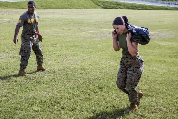 """A U.S. Marine with Marine Corps Installations Pacific (MCIPAC), competes in the High Intensity Tactical Training (HITT) Preliminary Challenge on Camp Hansen, Okinawa, Japan, June 15, 2019. Winners of the challenge earn a chance of traveling back to the United States to compete in the HITT Championship, and possibly earning the title """"HITT Champion"""". (U.S Marine Corps Photo by Lance Cpl. Christopher Madero)"""