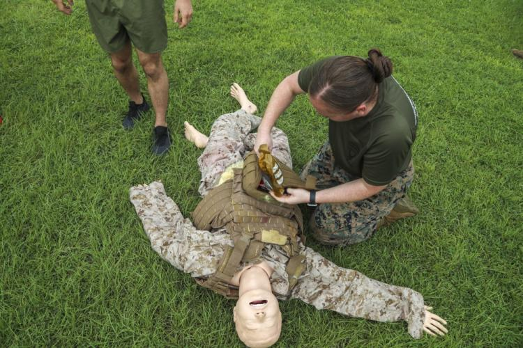 U.S. Navy Chief Hospital Corpsman Anaalicia Henderson, assigned to 3rd Medical Battalion, 3rd Marine Logistics Group (3rd MLG), provides care to a simulated casualty June 17, 2019 on Camp Foster, Okinawa, Japan. Henderson was competing in the inaugural Corpsman Challenge in Okinawa, hosted by 3rd Medical Battalion, 3rd MLG. (U.S. Marine Corps photo by Lance Cpl. Savannah Mesimer)