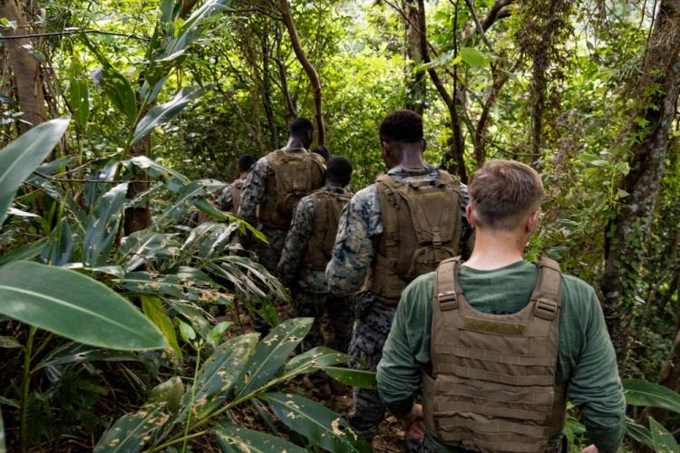 Aspiring Marine Corps Martial Arts Program Instructors navigate through the endurance course Aug. 23, 2019 on Camp Hansen, Okinawa, Japan. The endurance course is designed to test the individuals' abilities and teamwork. (U.S. Marine Corps photo by Lance Cpl. Brennan J. Beauton)