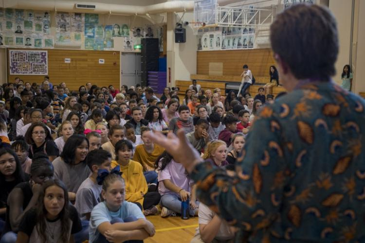 Valerie Roshong, a teacher with Lester Middle School, speaks to students about school rules, Aug. 27, 2019 on Camp Lester, Okinawa, Japan. Marines from across Okinawa visited LMS to interact with students, and help facilitate a variety of fun team building activities to introduce the new school year. (U.S. Marine Corps photo by Lance Cpl. Karis Mattingly)