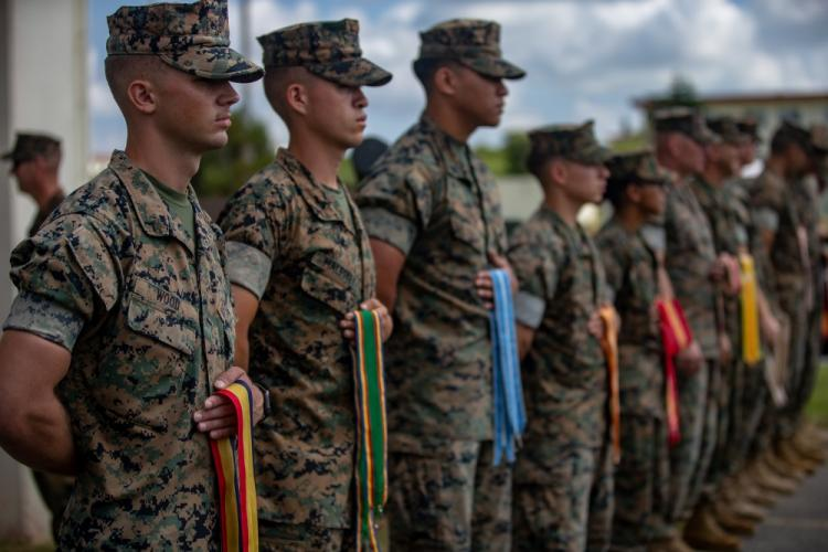 U.S. Marines with 12th Marine Regiment, 3rd Marine Division, participates in the 12th Marine Regiment 92nd Anniversary Battle Colors Rededication Ceremony on Camp Hansen, Okinawa, Japan, Oct. 4, 2019. The ceremony is an opportunity for Marines to remember warriors past and to recognize contributions of service members and families to current operations. (U.S. Marine Corps photo by Lance Cpl. D'Angelo Yanez)
