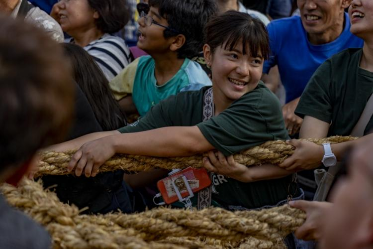 A festival attendee pulls the 200-meter-long, 43-ton rope during the 49th annual Naha Great Tug-of-War Festival, Oct. 13, 2019 at Naha City, Okinawa, Japan. The event symbolizes a struggle between warring factions during the reign of the Ryukyu Kingdom on Okinawa. The event is considered the world's largest tug-of-war. (U.S. Marine Corps photo by Lance Cpl. Brennan J. Beauton)