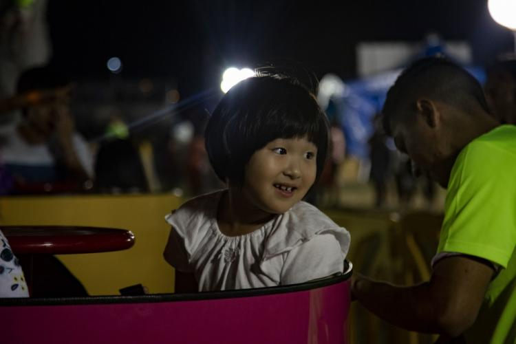 Members of the local and U.S. communities participate in the Fun Land rides during Kinser Festival on Camp Kinser, Okinawa, Japan, on Oct. 26-27, 2019. The two day festival gave attendees a chance to relax and enjoy food provided by vendors, play fun filled games, and enjoy music played by MAX, Marc E. Bassy, and Gnash. (U.S. Marine Corps photo by Lance Cpl. Karis Mattingly)