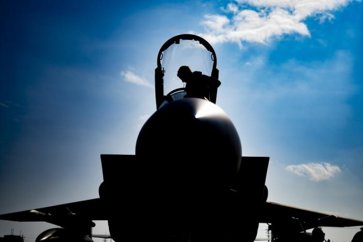 U.S. Air Force Lt. Col. Craig Van Beusekom with 44th Fighter Squadron, exits his F-15C Eagle during an Agile Combat Employment at Marine Corps Air Station Futenma, Okinawa, Japan, Feb. 21, 2020. The exercise is a partner concept to the Marine Corps' Expeditionary Advanced Base concept, and enables the Air Force to rapidly Command, Control, and logistically support it's aircraft within the enemies Weapon Engagement Zone. (U.S. Marine Corps photo by Cpl. Kameron Herndon)