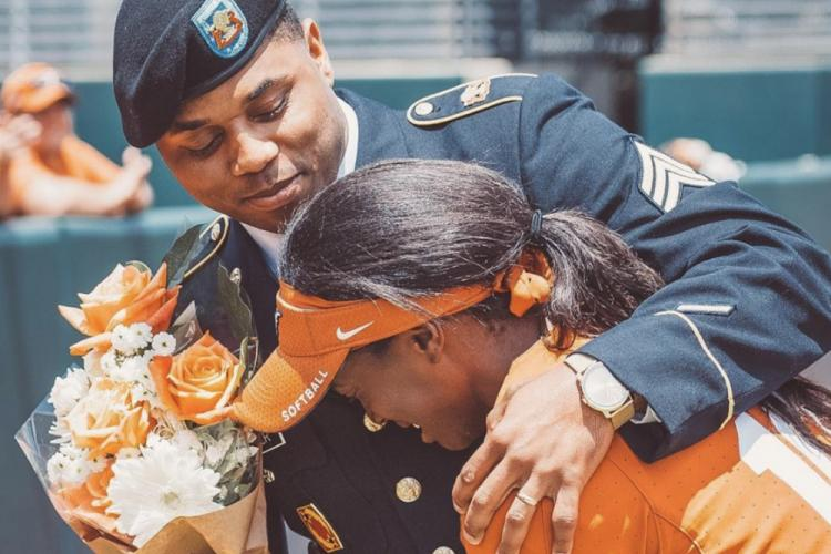 Sergeant La'Kedran Hayter, a patriot launching station enhanced operator assigned to 1st Battalion, 1st Air Defense Artillery Regiment hugs is his sister, Ki'Audra Hayter, a softball player for the University of Texas at Austin during senior day on May 5, 2019 at Red and Charline McCombs Field in Austin, Texas. (Courtesy photo)