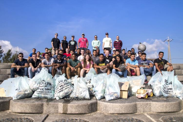 U.S. Marines pose for a group photo after cleaning Gushikawa Beach, Okinawa Japan, Nov 7, 2019. The cleanup was hosted by Marines from Alpha Company, Headquarters and Support Battalion, Marine Corps Base Camp Smedley D. Butler in order to promote positive relationships between the military and local Okinawan residents. (U.S. Marine Corps photo by Cpl. Savannah Mesimer)