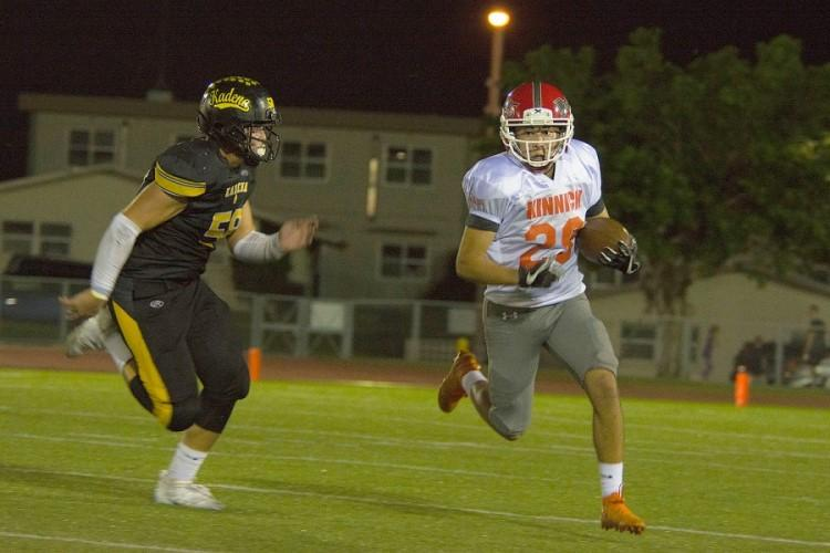 Anthony Santos, running back for the Nile C. Kinnick Devils, runs the ball during a game against the Kadena Panthers at Habu Field on Kadena Air Base, Okinawa, Japan, Friday, Oct. 18, 2019. (CARLOS M. VAZQUEZ II/STARS AND STRIPES)
