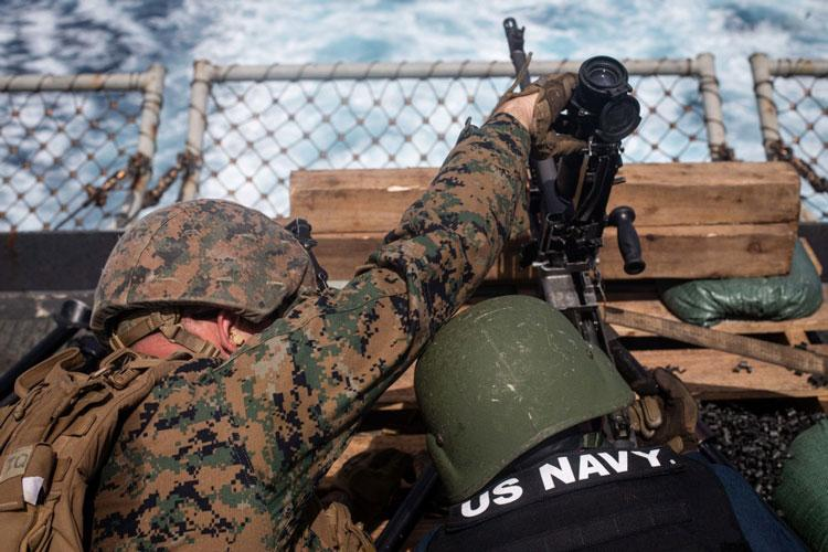 EAST CHINA SEA (Sept. 21, 2020) A U.S. Navy Sailor embarked on dock landing ship USS Germantown (LSD 42) and a Marine with Battalion Landing Team, 2nd Battalion, 4th Marines, 31st Marine Expeditionary Unit (MEU) operate a M240B medium machine gun during a crew served weapons shoot. (U.S. Marine Corps photo by Sgt. Danny Gonzalez)