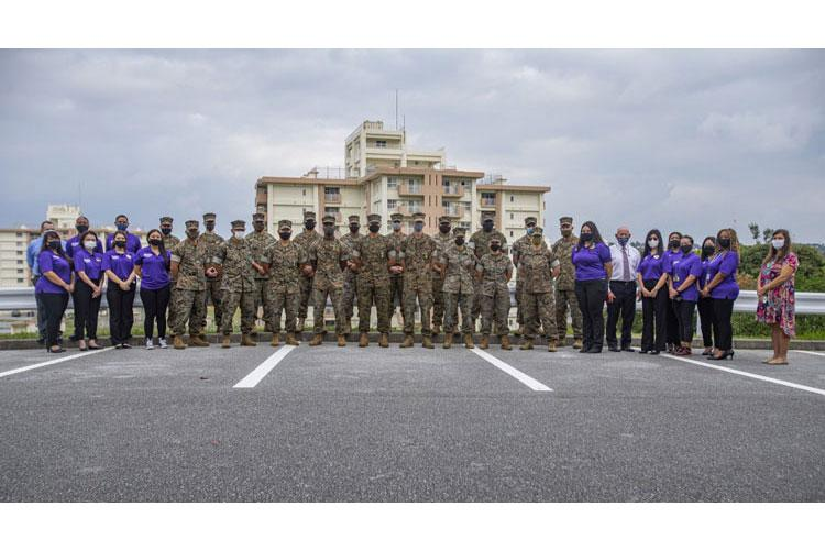 U.S. Marines with Task Force Permanent Change of Station (TF PCS) and Marine Corps Community Service staff (MCCS), pose for a photo after presented with awards for their successful support in the island-wide COVID-19 mitigation effort, Camp Foster, Okinawa, Japan, Oct. 30, 2020. (U.S. Marine Corps photo by Cpl. Karis Mattingly)