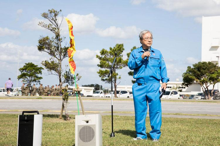 Masakatsu Kamiyama, vice mayor of Chatan Town, speaks to during a closing ceremony as part of a Tsunami Evacuation Drill, Camp Foster, Okinawa, Japan, Nov. 9, 2019. The drill was held to convey the readiness and capabilities of the camp to members of the U.S. and local communities in the event of an emergency. (U.S. Marine Corps photo by Cpl. Kayla V. Staten)