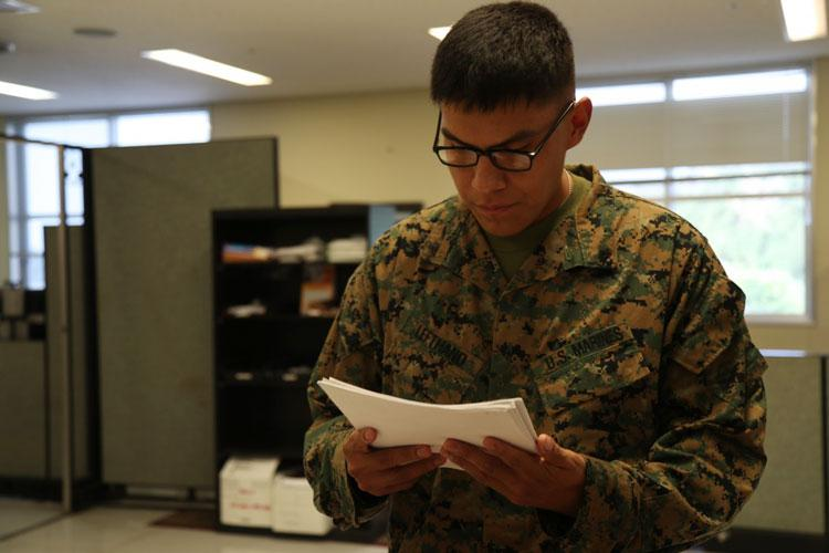U.S. Marine Corps Lance Cpl. Percival Lefthand, a distribution management specialist with the distribution management office, Headquarters and Support Battalion, Marine Corps Installations Pacific-Camp Smedley D. Butler, reviews paperwork at the distribution management office on Camp Foster, Okinawa, Japan Nov. 13, 2019. Lefthand grew up on the Crow Reservation in southern Montana and lived there all his life prior to enlisting. (U.S. Marine Corps photo by Lance Cpl. Ryan H. Pulliam)