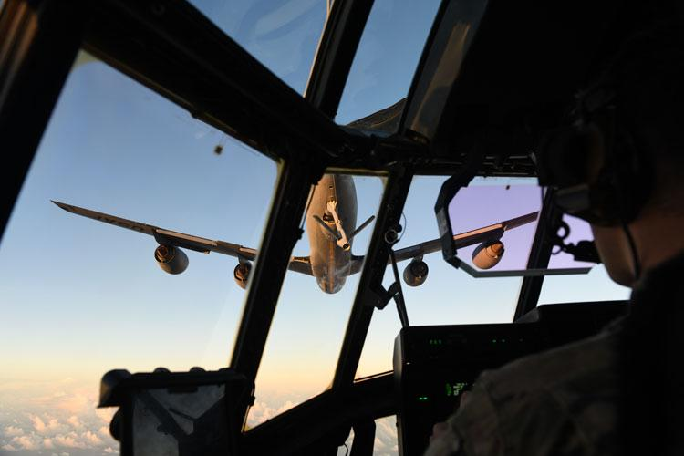 A pilot assigned to the 17th Special Operations Squadron, 353rd Special Operations Group, Kadena Air Base, Japan, prepares an MC-130J Commando II for aerial refueling with a KC-135 Stratotanker from the 909th Air Refueling Squadron, during Exercise Gryphon Pacific 20-1, Nov. 15, 2019, over the Pacific Ocean. (U.S. Air Force photo by Staff Sgt. Benjamin Sutton)
