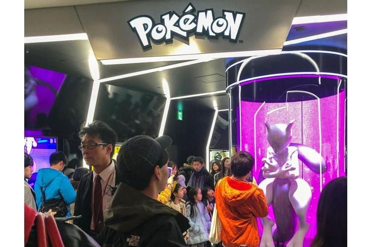 Customers take photos of a Mewtwo statue while waiting to enter the Pokemon Center near Nintendo Tokyo in Shibuya, Sunday, Dec. 1, 2019. (CHRISTIAN LOPEZ/STARS AND STRIPES)