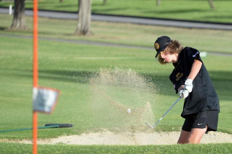 Kadena's Carter Johnson blasts out of the bunker on the 12th hole. (Dave Ornauer/Stars and Stripes)