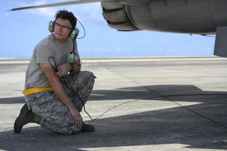 U.S. Air Force Airman 1st Class Braxton Dalton, a 14th Aircraft maintenance squadron crew chief, runs preflight checks at A.B. Won Pat International Airport, Guam, April 24, 2019. Misawa Air Base Airmen and aircraft deployed to Guam for Resilient Typhoon, an exercise designed to strengthen airpower dispersal capabilities within the Indo-Pacific region. (U.S. Air Force photo by Staff Sgt. Brittany A. Chase)