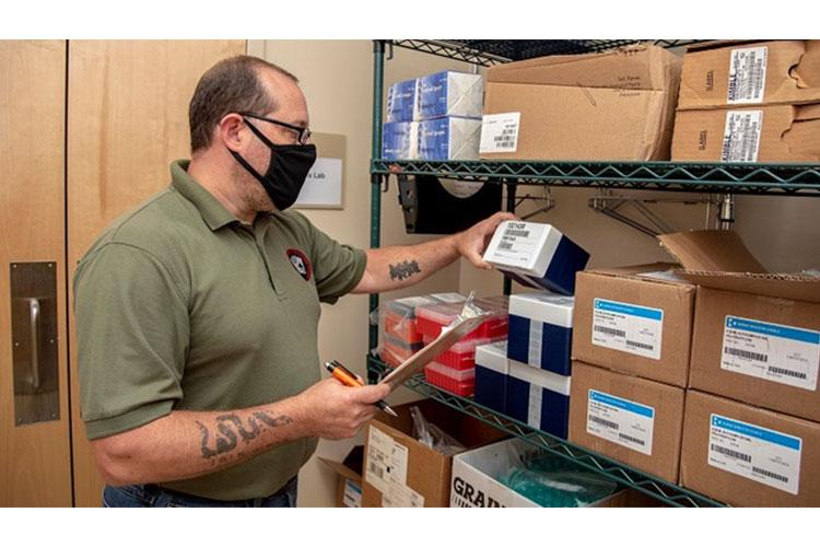 Mr. Michael Ende, Armed Forces Medical Examiner System inventory manager, checks inventory of supplies in the Forensic Toxicology Laboratory at Dover Air Force Base, Delaware, July 8, 2020. Ende serves as a civilian contractor with AFMES maintaining the inventory of all laboratory and chemical supplies. (U.S. Air Force photo by Tech. Sgt. Nicole Leidholm)