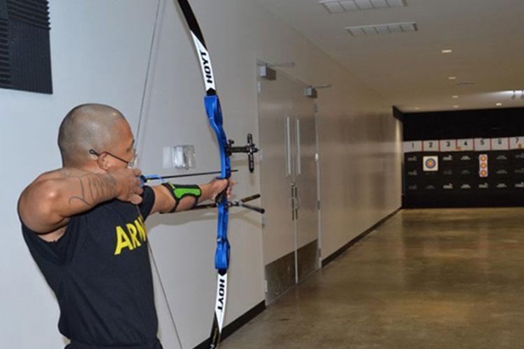 Army Staff Sgt. Gene Calantoc, a member of the Soldier Recovery Unit at Brooke Army Medical Center, prepares to loose an arrow during the Virtual Army Trials archery event held at Buck and Doe's Mercantile in San Antonio, Texas, March 10, 2021. Calantoc is one of several Soldiers at the SRU competing to be selected to represent Team Army in the 2021 DoD Warrior Games (Photo by: Daniel J. Calderón, Brooke Army Medical Center).