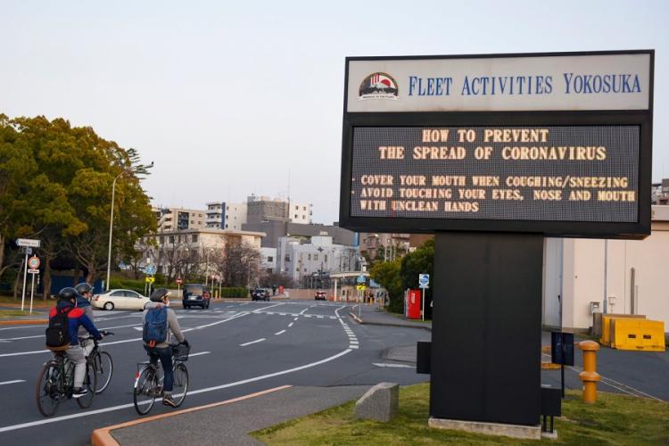 A sign displays coronavirus-prevention information at Yokosuka Naval Base, Japan, March 26, 2020. TYLER FRASER/U.S. NAVY