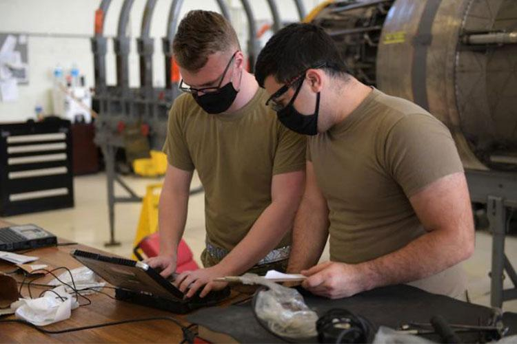 Airmen from the 18th Component Maintenance Squadron check diagnostics for an F-100 jet engine on Kadena Air Base, Japan. The F-100 engines are part of the F-15 fighter jet assigned to Kadena, whose primary mission is to provide ready air and space power to promote U.S. interests in the Indo-Pacific region during peacetime, through crisis and in war. (U.S. Air Force photo by Staff Sgt. Daryn Murphy)